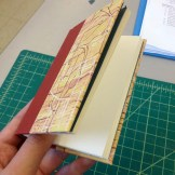 Action shot of the Quarter covered case binding using a recycled relief monotype